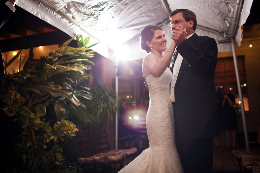 fun clever wedding reception at the daily review cafe in houston photographed by wedding photographer table4 weddings