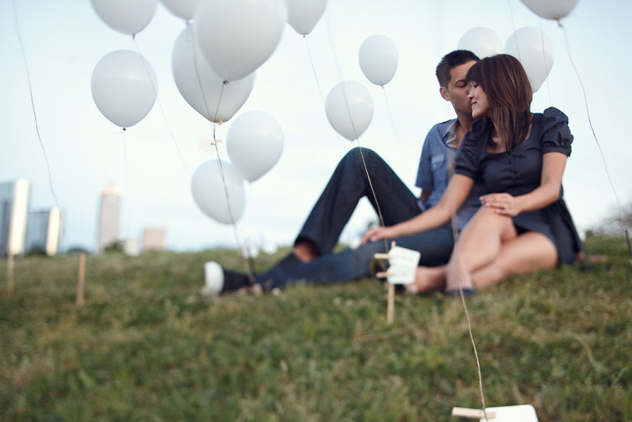 fun creative engagement session with white balloons by dallas wedding photographer table4