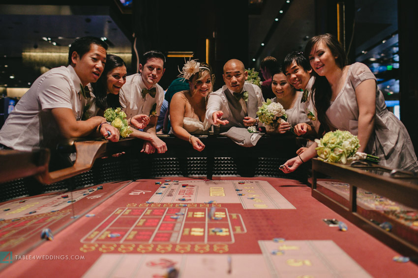 las vegas wedding, aria wedding, cosmopolitan wedding, craps table with wedding party