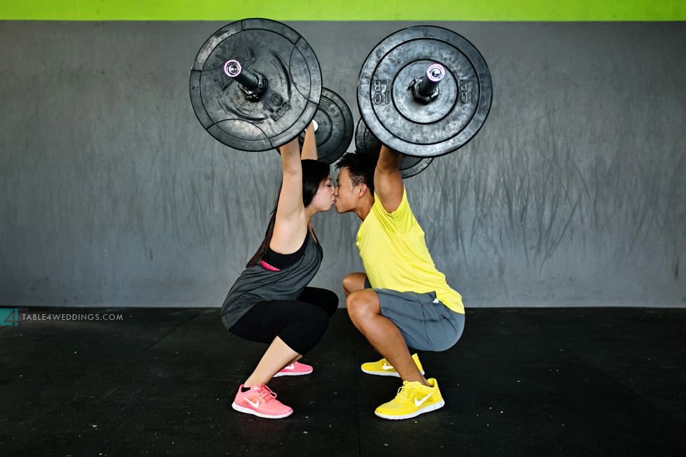 crossfit squats kissing engagement photo