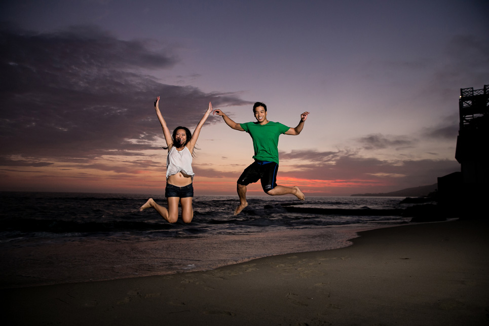 laguna beach sunset jumping engagement photo, sexy southern california wedding photographer jason huang