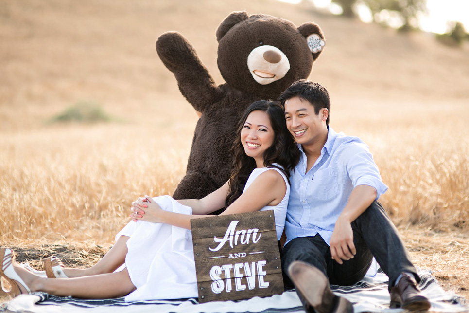 weird riley wilderness park engagement photo, southern california wedding, stuffed bear from costco