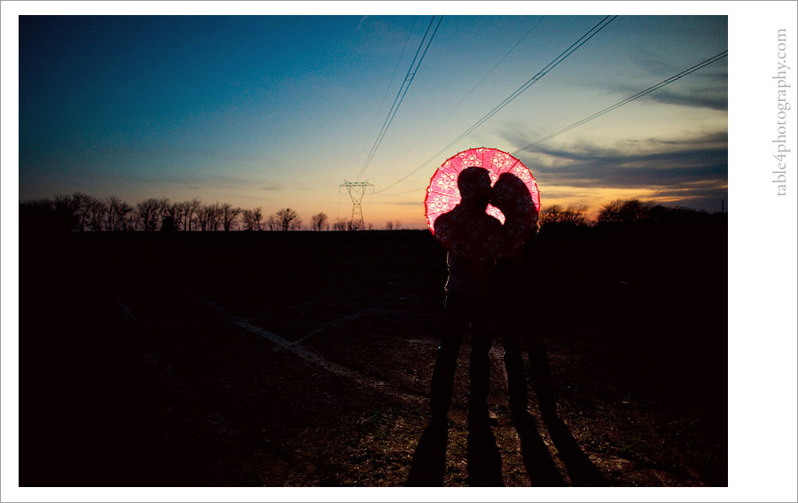 pink umbrella sunset engagement image