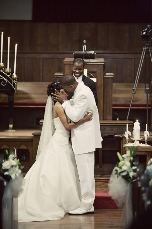 wedding first kiss, altar, pastor image
